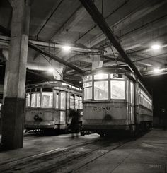 """Shorpy Historical Photo Archive :: Park Terminal: April 1943. """"Baltimore, Maryland. Trolleys inside the Park Terminal at night."""" Photo by Marjory Collins for the Office of War Information."""
