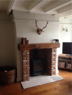 An inspirational image from Farrow and Ball Living Room possible – fantastic room avesome Wood Burner Fireplace, Cosy Fireplace, Living Room Decor Fireplace, Cottage Fireplace, Inglenook Fireplace, Brick Fireplace, Fireplace Design, Brick Hearth, Fireplaces