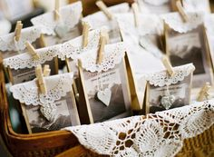 Simple brown bags trimmed in paper doilies closed with a tiny clothespin and heart charm...what a sweet favor.