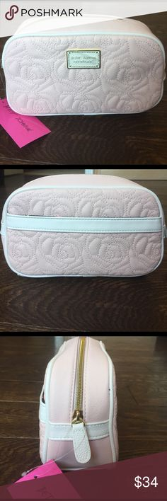 Betsey Johnson Cosmetic Bag! Beautiful makeup bag by Betsey Johnson that is brand new! Blush colored bag with embroidered roses on the outside. Inside is navy colored with a rose patterned fabric! Absolutely beautiful makeup bag to add to any collection! Betsey Johnson Bags Cosmetic Bags & Cases