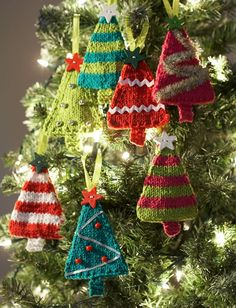 These knitted Christmas ornaments will look absolutely adorable on your holiday pine. Decorate your Christmas tree with mini me's with these Tiny Tree Ornaments.