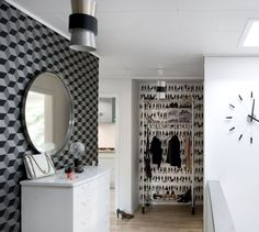 Black and white entrance featuring Ferm Living's 'Fashion' wallpaper and 'Squares' wallpaper.