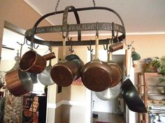 Metal pot rack with copper pots. Copper Pots, Copper Kitchen, Pan Rack, Hanging Pots, Wind Chimes, Kitchen Ideas, Kitchens, Decor Ideas, Decorating