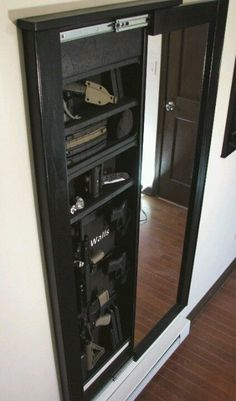 Gun storage hidden in a mirror. Put it in the closet with a lock and even your kids wont think notice it.