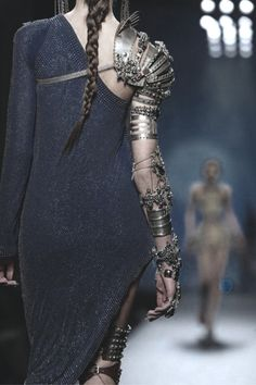Interesting accessory. (By N E U R O M Æ N C E R?) I do believe she could rock a bow and arrow like a boss.