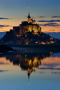 Mont St-Michel...i wanna go here! It looks like the castle at Disneyland! :)