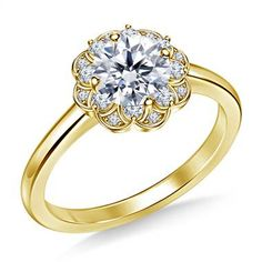 Demure and feminine, the elegant simplicity of this stylish design evokes the beauty and softness of flowers. The halo of diamonds has graceful edges with pave settings, surrounding your center stone in a brilliant embrace. Expertly crafted in 14K yellow gold, this engagement ring features a prong setting to showcase your center stone.