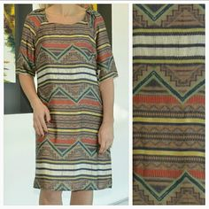 "Tribal print dress *Brand New with tag* Brand New with tag Classy tribal print tunic style dress. Goregous array of colors. Flattering fit. Pairs easily with heels and a floppy hat or dress it down with flats and a denim jacket.  Length 36"" Bust 18"" Sleeves 14"" 100% polyester Size medium Colors: orange, browns, cream,yellows, greens,navy blue Dresses"