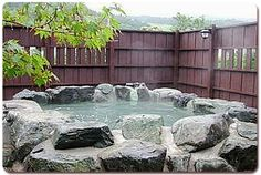 Natural rock spa quarried from behind the house? Built from concrete and stone!