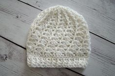 "Crochet Divine Beanie 0-3 Months - White Sequin. The Hat In This Listing Is Ready To Ship. Hand crocheted Divine Beanie has shells and cables for a beautiful spiral design, with cables through the hat, and around the brim. The yarn is a solid white yarn with white sequins and metallic thread running through out. Measurements: 5.5"" from the top of the hat to the brim 13.25"" around the brim. Will fit heads with a circumference of 13"" - 14.25"" One size most infants 0-3 months Hand crocheted…"