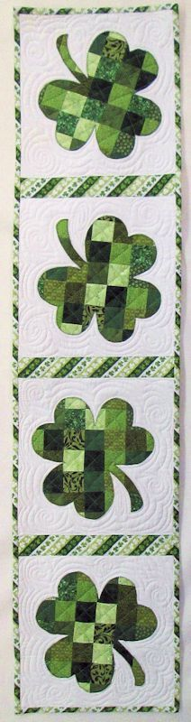 This quilt runner design would translate really well into a card using 1 inch scraps behind a cutout.  Might have to give this a try.  Shabby Fabrics Patchwork Shamrock Table Runner Kit