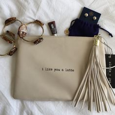 """Olivia + Joy """"I like you a latte"""" cream clutch Perfect for your next coffee date! Gotta love that tassel! 10 inches wide by 7 inches tall. NWT. Olivia + Joy Bags Clutches & Wristlets"""