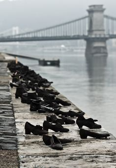 Shoes on the Danube Promenade - A row of 60 pairs of bronze shoes that look suddenly abandoned. The memorial was created by sculptor Gyula Pauer.  It honors the Jews who were killed by the fascist Arrow Cross militiamen in Budapest during World War II as Allied forces approached the city.     They were ordered to take off their shoes, and were shot at the edge of the water so that their bodies fell into the river and were carried away. It represents their shoes left behind on the bank