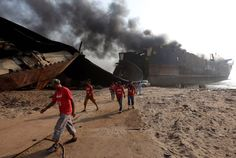 Rescue workers walk near the burning oil tanker at the ship-breaking yard in Gaddani, Pakistan, November REUTERS/Akhtar Soomro Ship Breaking, Oil Tanker, Sailing Adventures, Pakistani, November 2, Beaches, Boats, Scrap, Ships