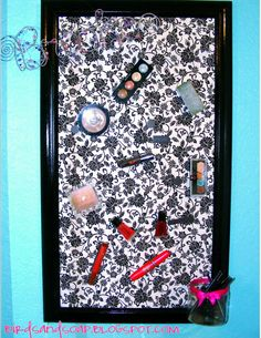 Fabric covered magnet board, add magnets to make-up containers (or whatever you want to put on the board) and you have a cool new storage for all your product. From Birds and Soap