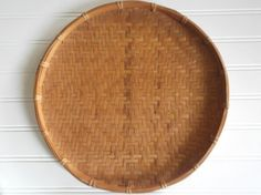 Boho Chic round rattan tray with raised lip.  This is a vintage mid century modern woven tray with elements of wicker, rattan and bamboo.  Perfect for your Rustic, Boho and Mid Century Modern Decor.  Makes a great Bohomenian wall hanging piece. Use as a bed tray, table top tray or vanity decor.  Measures approximately 12 around.  Raised edge approximately 3/4 high.  Edges are wrapped with bamboo. Reeds are in good condition with a few loose due to age.  For more Boho decor, click link:  ...