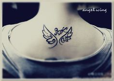 comic style angel wing tattoo designs on the back with heart in the middle