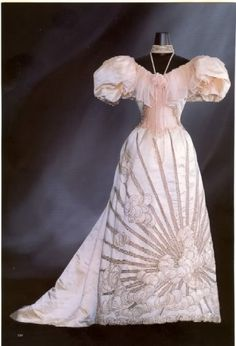 Charles Frederick Worth, Evening Dress of Ivory Satin and Chiffon; Skirt with Sunbeam & Cloud Pattern of Bead Embroidery. Paris.