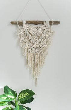 FREE SHIPPING within Australia. Use code: SPRING2017 at checkout. A macrame wall hanging is the easiest way to add a little bohemian style to any home. The modern combination of beige cord on white driftwood will blend perfectly with any existing decor. This wall hanging has been made using a variety of soft, curved macrame knots with beige 3mm cotton string. Hung from a beautiful piece of Australian driftwood. This item is designed to be a statement piece for your home. Hand made in…