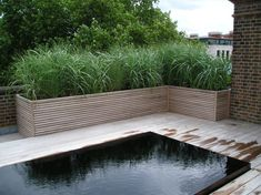 Wooden planters and decking by Peter Doy & Son. Garden design by Jinny Blom, Chelsea, London