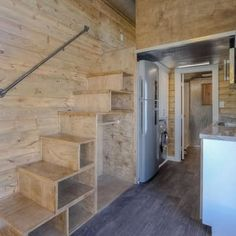 Storage-integrated stairs lead to the container's sleeping loft