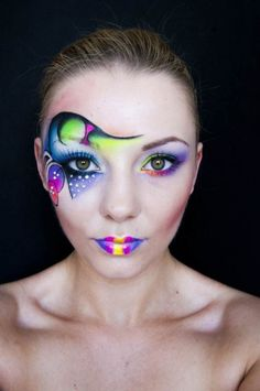A fluorescent rainbow of artistic makeup with clear gem accents.