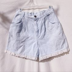 Plaid Lace Trim Shorts Adorable light blue and white plaid shorts.  Has eyelet lace trim throughout the bottom of each leg. Modern Essentials Shorts