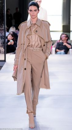 Look: Kendall took the catwalk in an all-beige outfit including a trench embellished with ... #kendalljenner #londonfashionweek #lfw