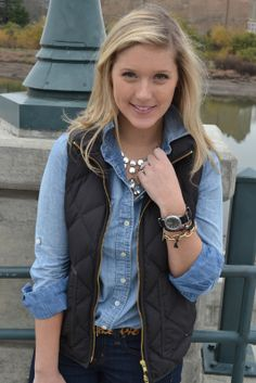 Denim shirt layered with a vest for fall.