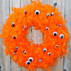 This fuzzy orange wreath guarantees trick-or-treaters won't miss your front door: http://www.bhg.com/halloween/indoor-decorating/halloween-door-decor-28-great-ideas/?socsrc=bhgpin092814monstereyeshalloweenwreath&page=6