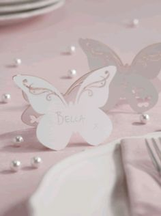 An exquisite butterfly wedding shaped place card with delicate swirls cut out of the wings. A beautiful free standing name card to add a touch of chic to your table. Each pack contains 10 butterfly place cards measuring x cm Butterfly Centerpieces, Butterfly Decorations, Butterfly Wedding Theme, Butterfly Party, Wedding Table Decorations, Decoration Table, Butterfly Place, White Butterfly, Butterfly Table