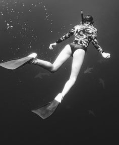 Olive Cook diving with sharks on the North Shore // In the 'Surf Capsule Salty Dayz Long Sleeve'