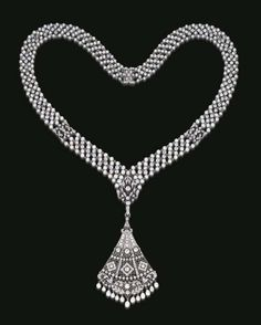 BELLE EPOQUE PEARL AND DIAMOND SAUTOIR Suspending a detachable openwork rose, single, old mine and old European-cut diamond fan-shaped pendant, by a similarly-set foliate surmount, from a pearl and diamond collet mesh chain, spaced by openwork single, old mine and old European-cut diamond square-shaped foliate links, mounted in platinum, ca. 1910, 22 ins.