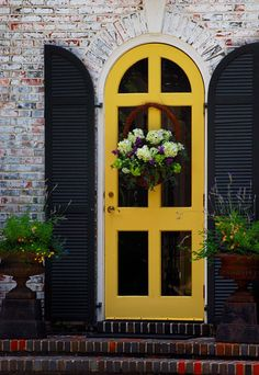Brick Wall and Upstairs Classic Doors Design Ideas with Hanging Flowers