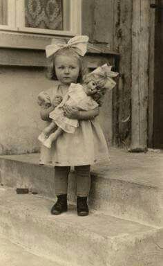 Little Girl With Her Doll