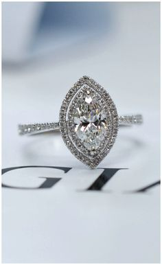 A custom engagement ring featuring a beautiful marquise cut diamond.