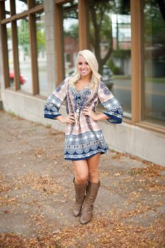 Paisley print tunic dress with v neck and colorblock hem and sleeves. Navy