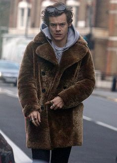 Harry Styles in London wearing Saint Laurent Buttoned Short Peacoat.