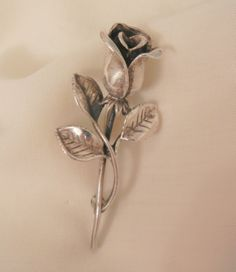 Always something exciting in store many items on sale from 10 to 60% off Lovely Sterling Vintage Rose brooch