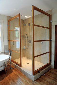 The wood on this updated shower is a nice nod to craftsman but maintaining a more modern look.