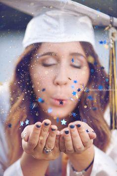 Grad blowing glitter and confetti.  Senior graduation picture idea