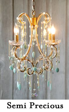 I love the idea of customising a normal chandelier with colourful stones..