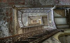 Another of Dan Raven's photos of decay, this one achieves a disorienting and scary Escher-like look at the stairs in abandoned hotel. from http://www.flickr.com/photos/odins_raven/8249570636/