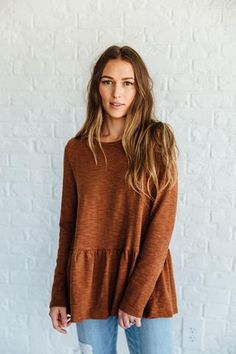 DETAILS: - Thick-knit, long-sleeve peplum, perfect for winter - The fabric content: 63% polyester, 26% cotton, 10% spandex - Model is wearing a small - Paired with Crystal Cove Jeans