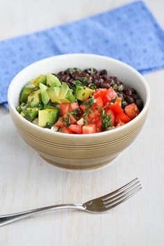 Easy Rice Bowl Recipe with Black Beans, Avocado & Cilantro Dressing {Vegetarian & Gluten-Free}... or my cilantro lime rice with marinated, grilled chicken breasts (to make it non-veg).    Regardless, must make this week!