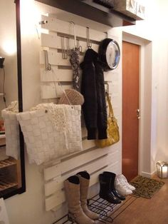 Paint a pallet white and hang stuff from it with overdoor hooks. Fantastic!