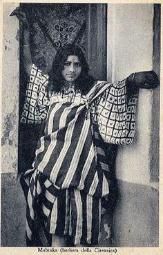 Libya  Amazigh  tattoo  Berber  Africa  Cirenaica || I like the stripe and square patterns on her garments.