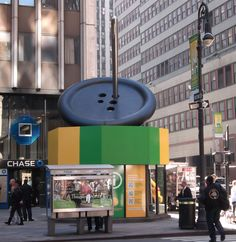 The giant needle and button at The Fashion District Information Center, New York City