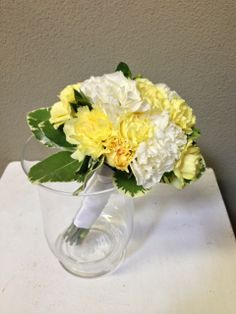 Green leaves add a fresh touch to this yellow and white carnation Mother's mini bouquet. Flowers by Seasonal Celebrations.