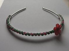 Check out this item in my Etsy shop https://www.etsy.com/listing/205437266/green-pink-beaded-tiara-with-pink-fimo